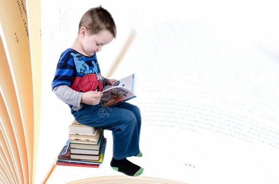Boy Reading on Stool