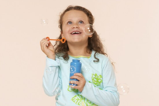 Girl Watching Bubbles