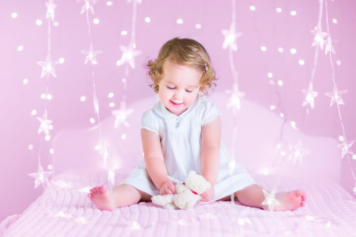 Cute Toddler Girl In A Bedroom