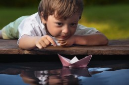 Little Boy with Paper Boat