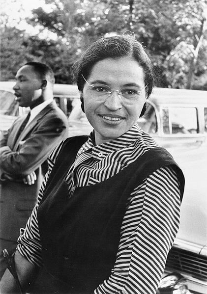 Rosa Parks with Martin Luther King, Jr. in the background.