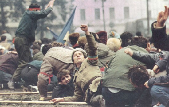 Communism falls in the Eastern Bloc. Revolutionaries on the streets during the Romanian Revolution of 1989.