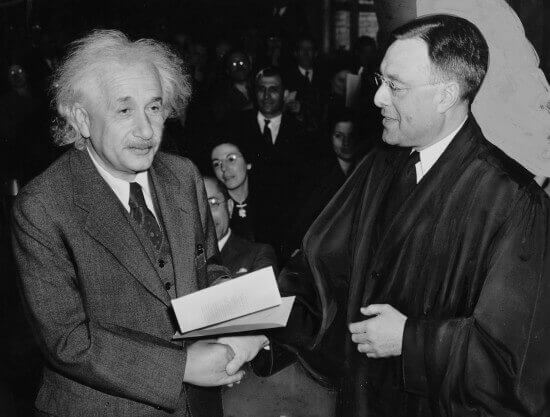 Albert Einstein receiving from Judge Phillip Forman his certificate of American citizenship.