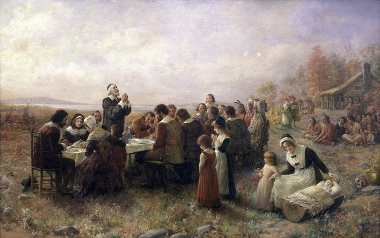 Thanksgiving at Plymouth Harbor with Pilgrims and Native Americans.