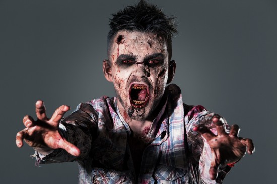 Aggressive, creepy zombie in clothes