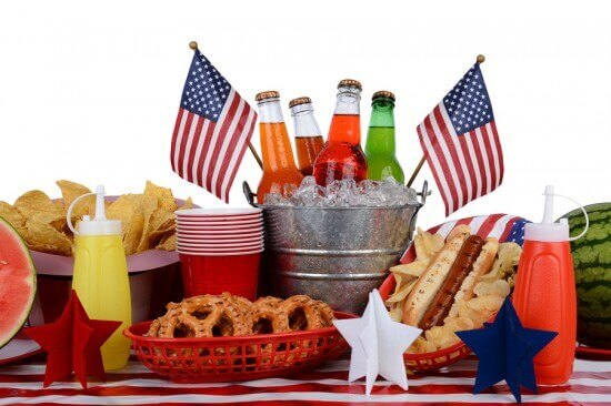 A picnic table set up with a Fourth of July theme. Horizontal fo