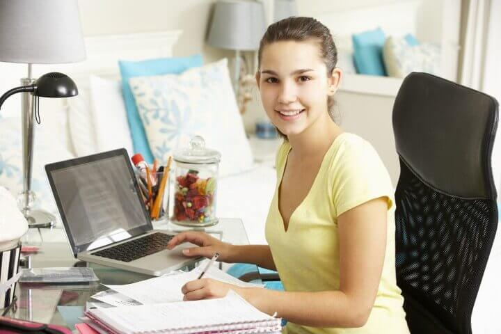 Teenage Girl Studying At Desk