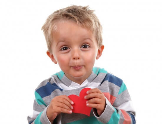 Little Boy Holding a Valentine